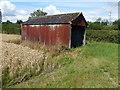 TL1188 : Rusty tin shed near Lutton Farm by Richard Humphrey