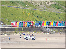 NZ8911 : Beach Huts by Whitby Sands from West Pier, Whitby by Christine Matthews