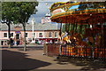 NY4055 : A Carousel in Market Square by Peter Jeffery
