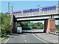 SJ8479 : Railway Crossing the Wilmslow Handforth Bypass by David Dixon