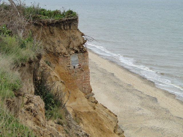 Subterranean building revealed in cliff face
