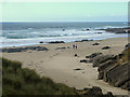 NR2066 : Walker on the beach at Saligo Bay by Oliver Dixon
