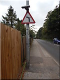 TM1543 : Bend to the left with side road to the right sign by Hamish Griffin