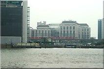 TQ3880 : View of a DLR train, Tower Hamlets Town Hall, Balfron Tower and Blackwall Yard from the Greenwich Peninsula by Robert Lamb