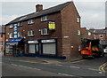 SJ8481 : Two Station Road shops near the corner of Warham Street in Wilmslow by Jaggery
