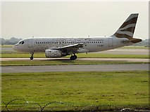 SJ8184 : Golden Dove Airbus at Manchester Airport by David Dixon