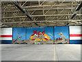 TG2623 : Mural in hangar 1 by Evelyn Simak