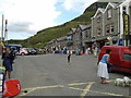 SX0486 : Shops, houses, cars, people, dogs at Trebarwith Strand by Rob Purvis