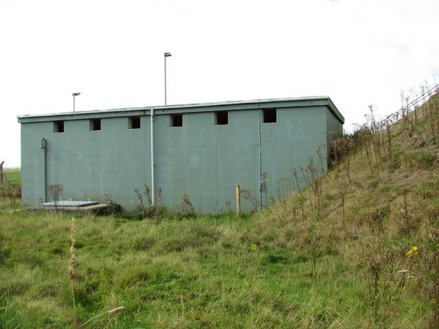 Building in fuel storage compound