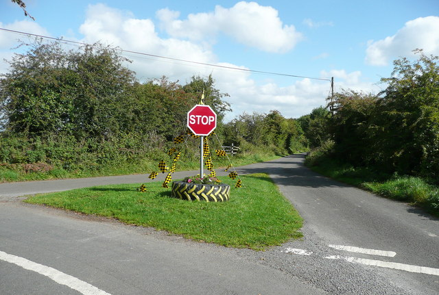 Grass triangle with road sign