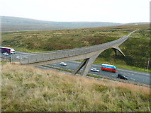 SD9814 : The Pennine Way footbridge over the M62 by Humphrey Bolton
