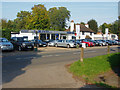 TQ0952 : Car salesroom, East Horsely by Alan Hunt