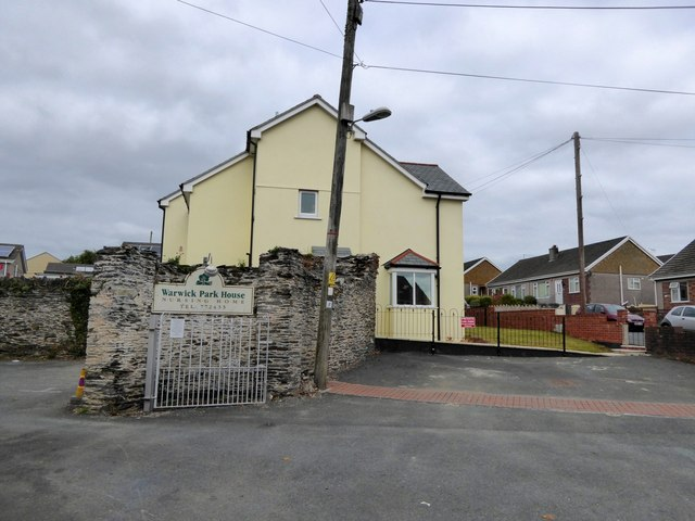 An old stone wall and modern development, Carew Avenue