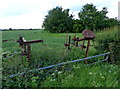 SP4085 : Old farm machinery next to the B4065 Leicester Road by Mat Fascione