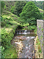SD9125 : Lydgate - weir at Fiddlers Bridge by Dave Bevis