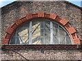 SJ3790 : Kensington drill hall window by John S Turner