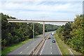 SP0266 : Jogging across Musketts Way footbridge near Headless Cross, Redditch by Robin Stott