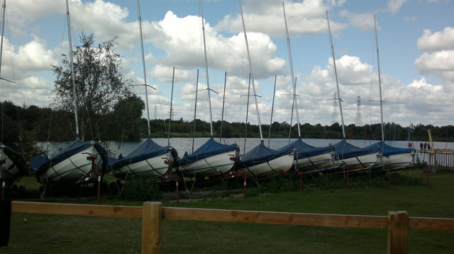 View of a row of boats moored up next to Russell's Lake