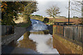 NT7969 : Flooding on the A1107 at Pease Bridge by Ian S