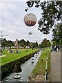 SZ0891 : The Bourne River, with the tethered balloon just ascending. Lower Gardens, Bournemouth by Derek Voller