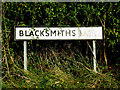 TM0959 : Blacksmiths Lane sign by Adrian Cable