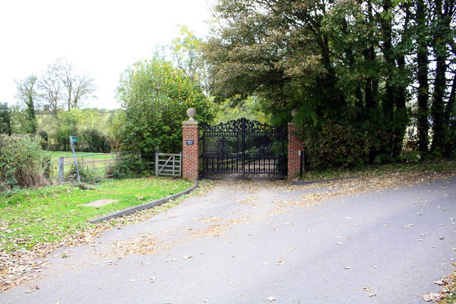 Footpath and house entrance from minor road