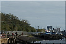 TQ8485 : View of the railway and the coastal path from the jetty next to the beach by Robert Lamb