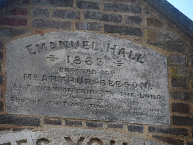 Plaque on gable of former chapel