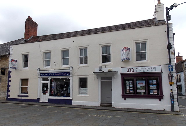 Charity shop and travel agents in Market Cross, Malmesbury