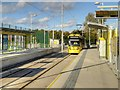 SJ8089 : Outbound Tram Arriving at Moor Road Metrolink Stop by David Dixon