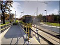 SJ8387 : Tram Leaving Benchill Metrolink Stop by David Dixon