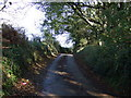 SW9643 : Uphill on a country lane by JThomas