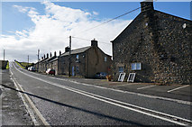 NY9084 : Houses on the A68 at Ridsdale by Ian S