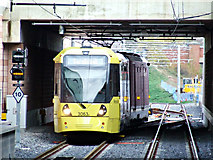 SJ8285 : Metrolink tram approaching Manchester Airport by Thomas Nugent