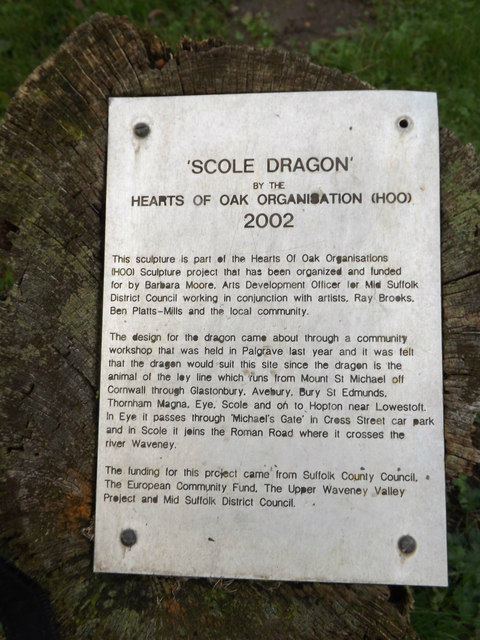 Plaque near Scole Dragon wood sculpture