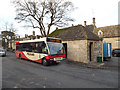 SP1114 : Bus, bus shelter and toilets, Market Place, Northleach by Robin Stott