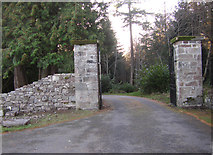 NH6037 : Gated entrance to Aldourie Castle by Peter Bond