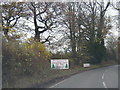 SJ4232 : A528 northbound Festive signs by Colin Pyle