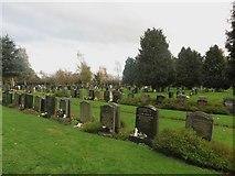 NY3853 : Graves in Ward 20, Carlisle Cemetery by Graham Robson
