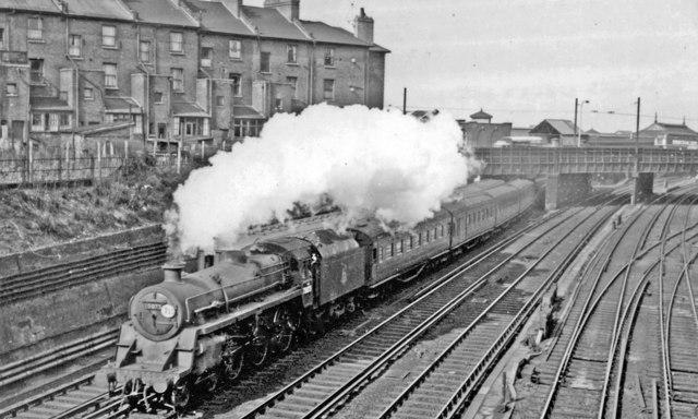 Waterloo - Basingstoke train pulling away from Clapham Junction, 1958