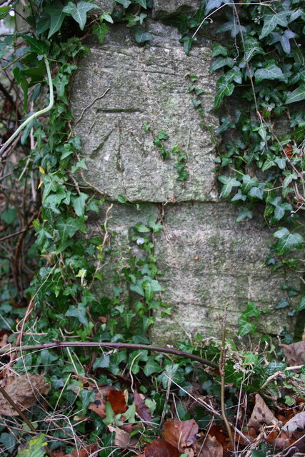 Benchmark on gatepost for track off Over Norton Road
