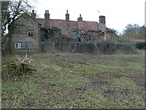 TF8825 : Derelict cottages in East Raynham by Richard Humphrey