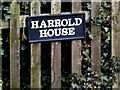 TM2084 : Harrold House sign by Adrian Cable