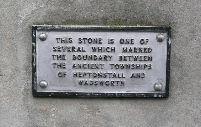 Plaque above township boundary stone
