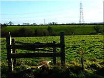 SU6514 : Rickety double stile with barbed wire by Shazz