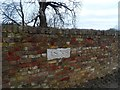 TL3018 : Date marker on wall to Woodhall Park by Bikeboy