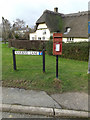 TL2356 : High Street Postbox & Harbins Lane sign by Adrian Cable
