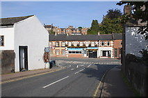 NY6820 : Shops beside B6542 viewed from Bridge Street by Roger Templeman