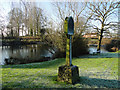 TG0827 : Wood Dalling village sign and pond by Adrian S Pye
