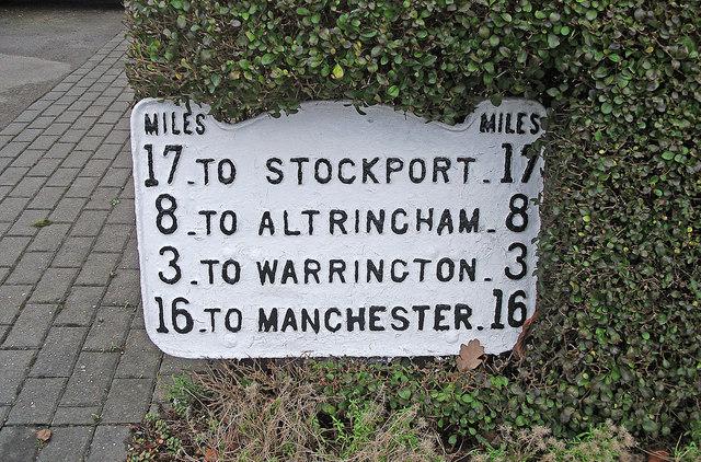 Metal milepost